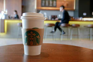 TIANJIN, CHINA - 2018/01/08: A coffee cup in a Starbucks coffee shop, arranged for photography. Since January 1st, Starbucks took back the management rights of more than 1300 stores in East China from the agent's hands, and has achieved 100% running and ownership in the mainland of China. The move is to speed up its expansion and development in China. (Photo by Zhang Peng/LightRocket via Getty Images)