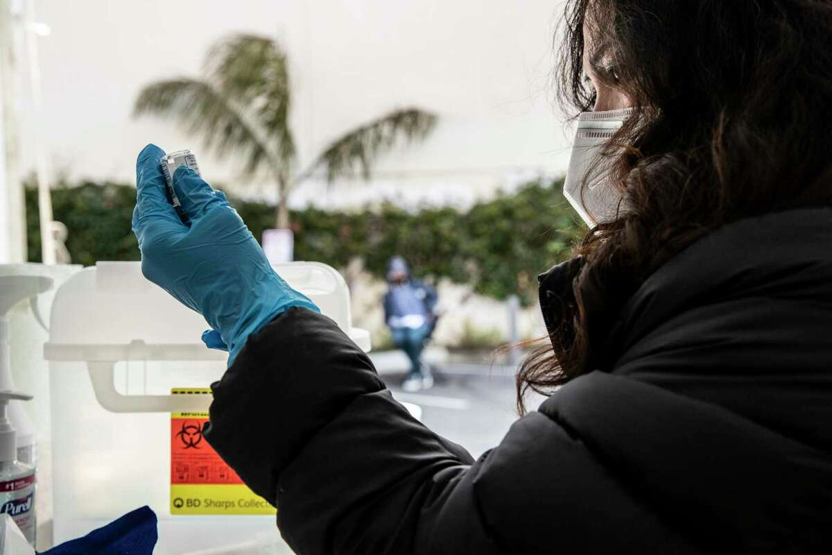 Nurse Joy Ceniza prepares a dosage of Moderna COVID-19 vaccine at a neighborhood vaccination site in the Excelsior district of San Francisco, California Wednesday April 7, 2021.