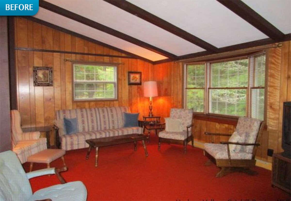 BEFORE: The wood-paneled living room of Robert Fuller's cabin in Jewett, New York.