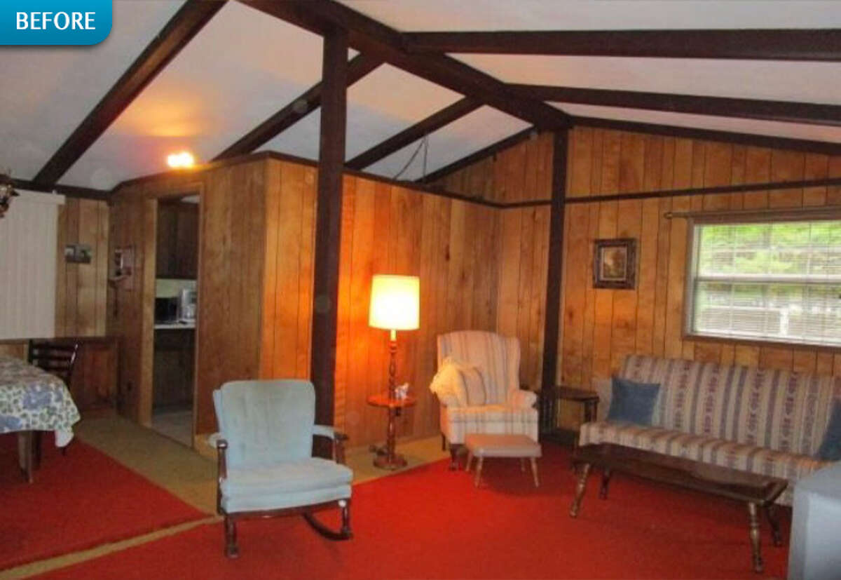 BEFORE: Wood-paneled walls segmented off the kitchen from the dining and living room spaces.