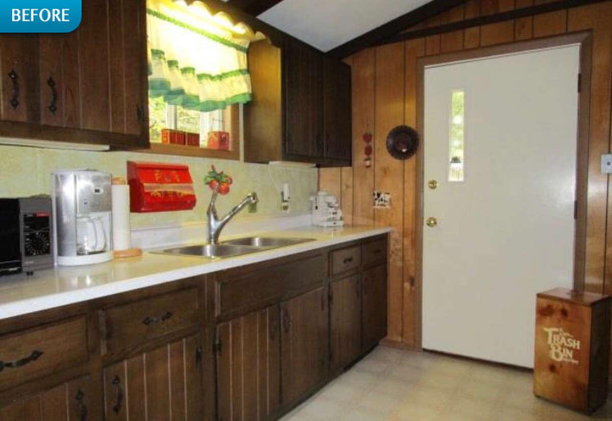 BEFORE: Inside the cabin's original kitchen.