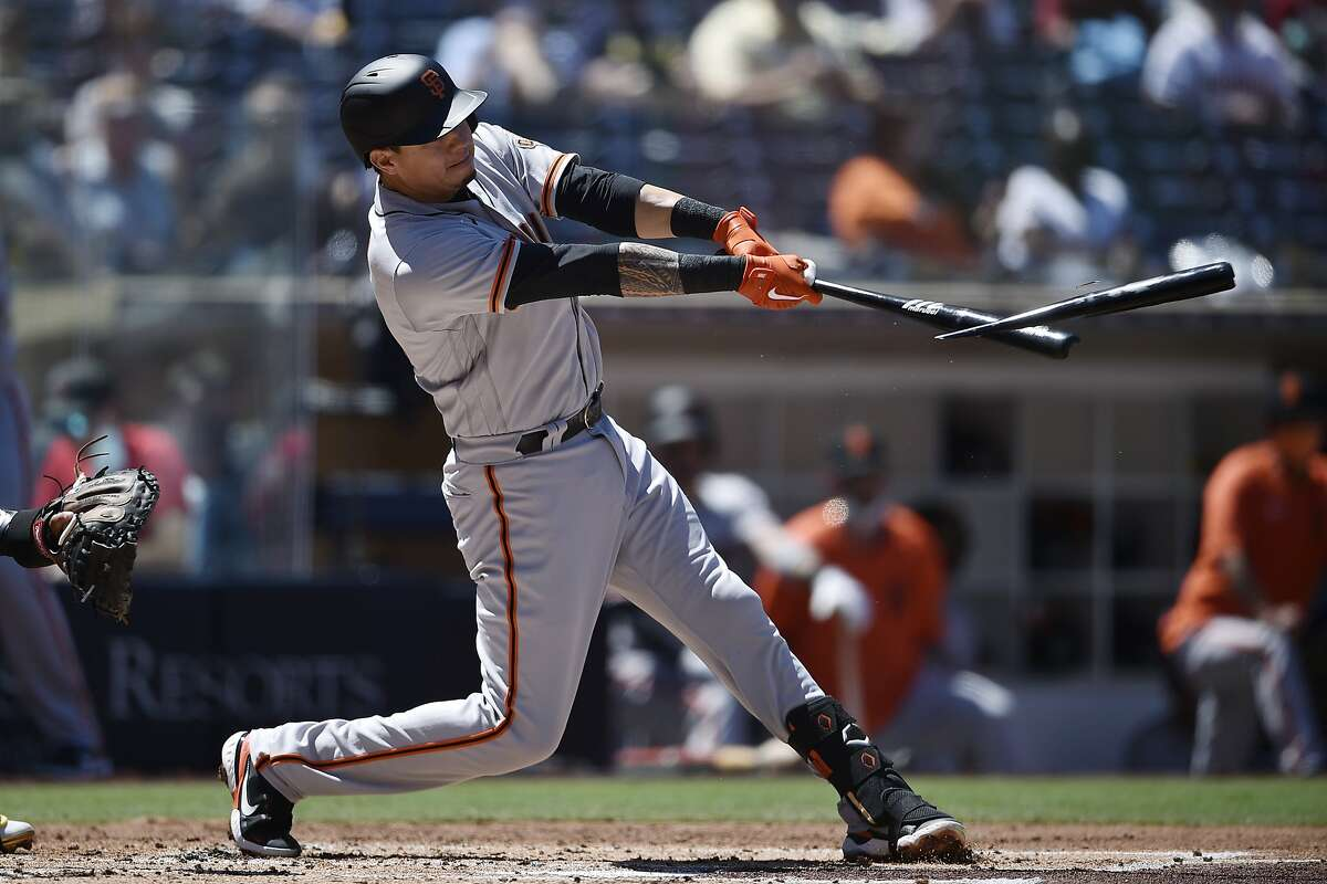 San Francisco Giants' Wilmer Flores breaks his bat on a hit during the second inning of the team's baseball game against the San Diego Padres in San Diego, Wednesday, April 7, 2021. (AP Photo/Kelvin Kuo)