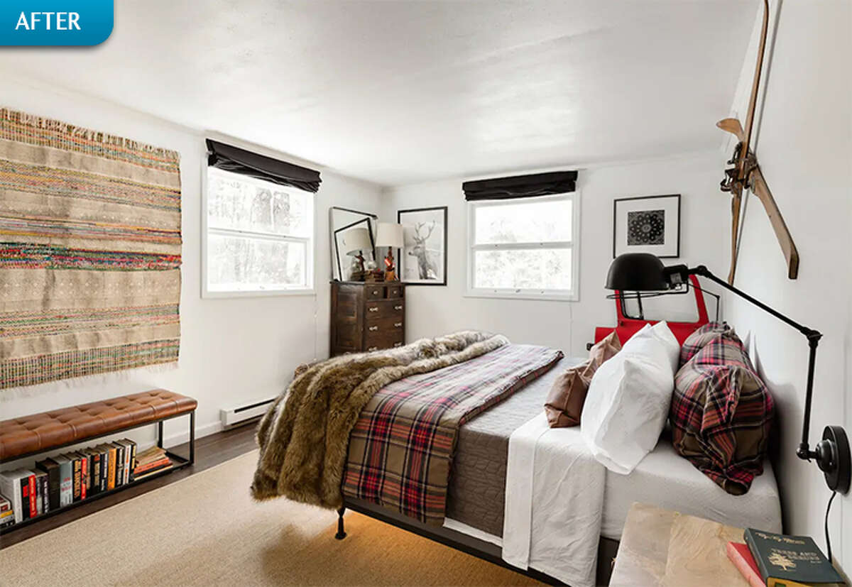 AFTER: Hardwood floors, fresh paint, and updated decor give the bedroom a more modern look that still feels very appropriate for a rustic cabin setting. Vintage skis provide a playful display in lieu of a headboard.