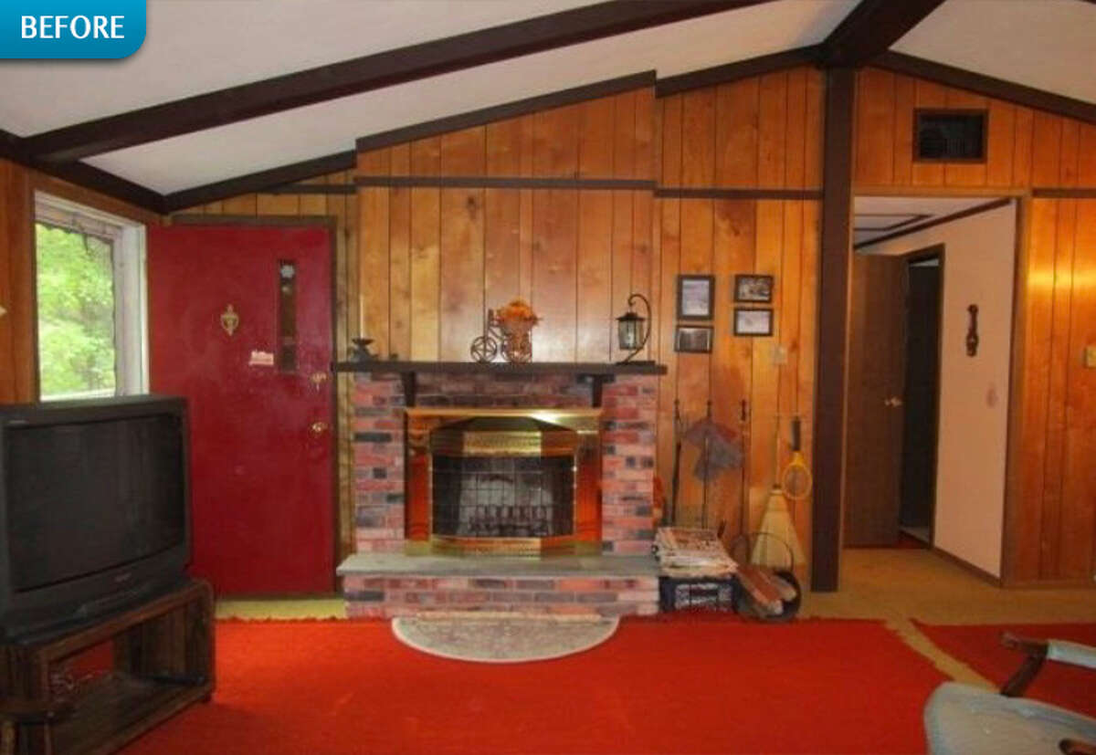 BEFORE: The cabin's original fireplace gets lost in the wood paneling.