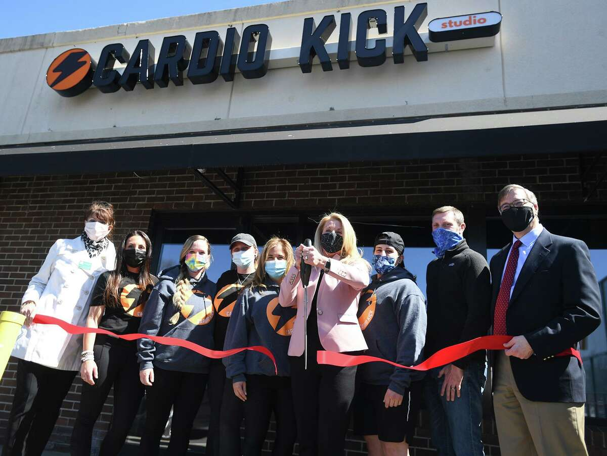 First Selectwoman Brenda Kupchick cuts the ribbon with co-owners Stacy DeSabella, fifth from left, and Rich Douglas, second from right, both of Fairfield, at the new Cardio Kick fitness studio at 2179 Black Rock Turnpike in Fairfield, Conn. on Wednesday, April 7, 2021.
