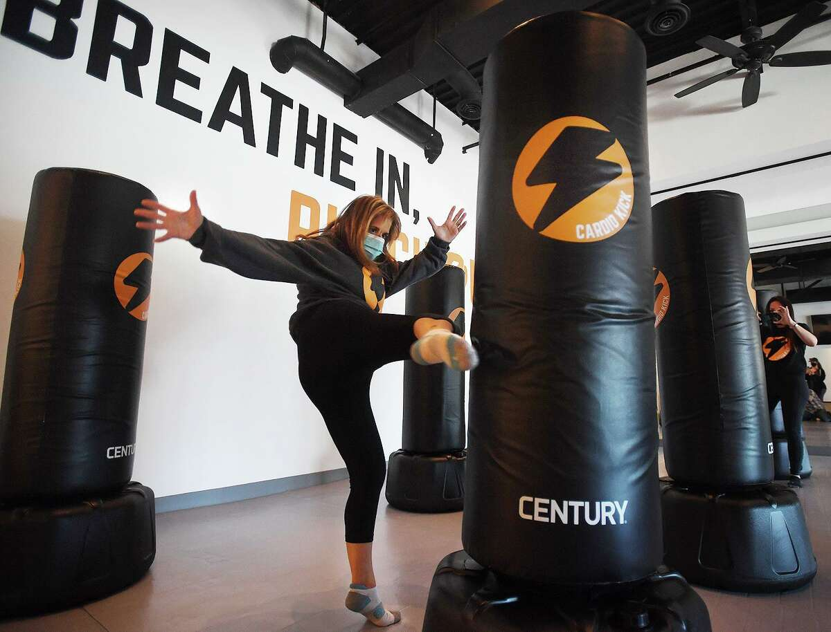 Co-owner Stacy DeSabella demonstrates her kick boxing moves during the grand opening of the new Cardio Kick fitness studio at 2179 Black Rock Turnpike in Fairfield, Conn. on Wednesday, April 7, 2021.