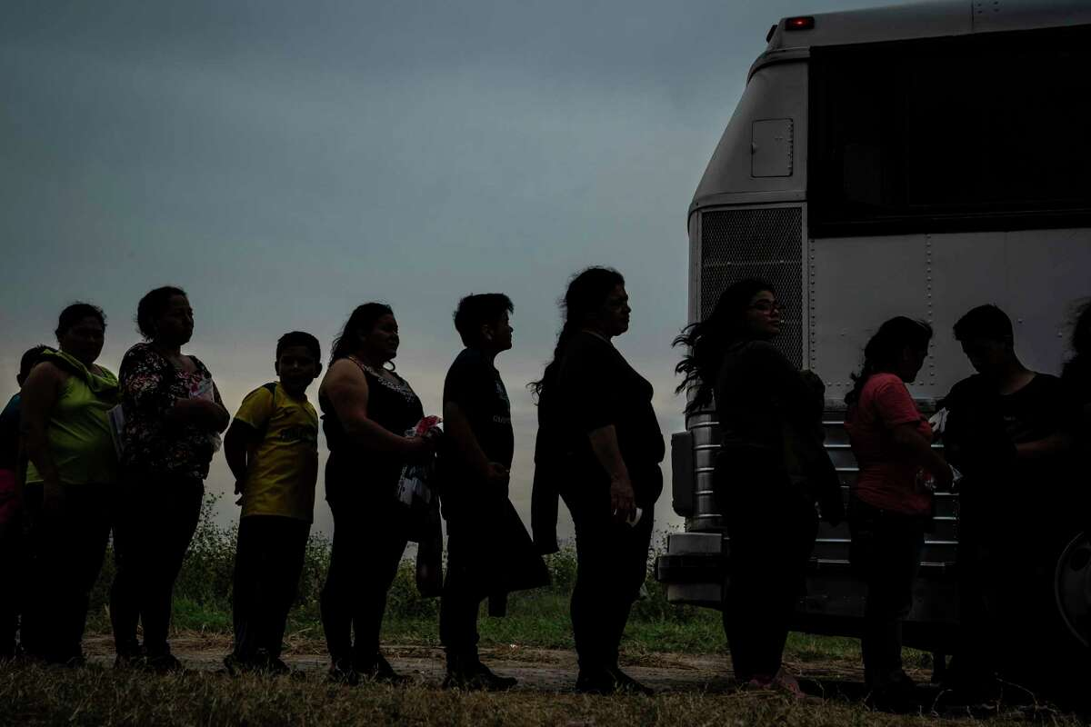 Immigrant families in Los Ebanos wait to board vans and buses that will take them to a Border Patrol station in 2019. Immigration plans abound in Congress, but all are flawed.