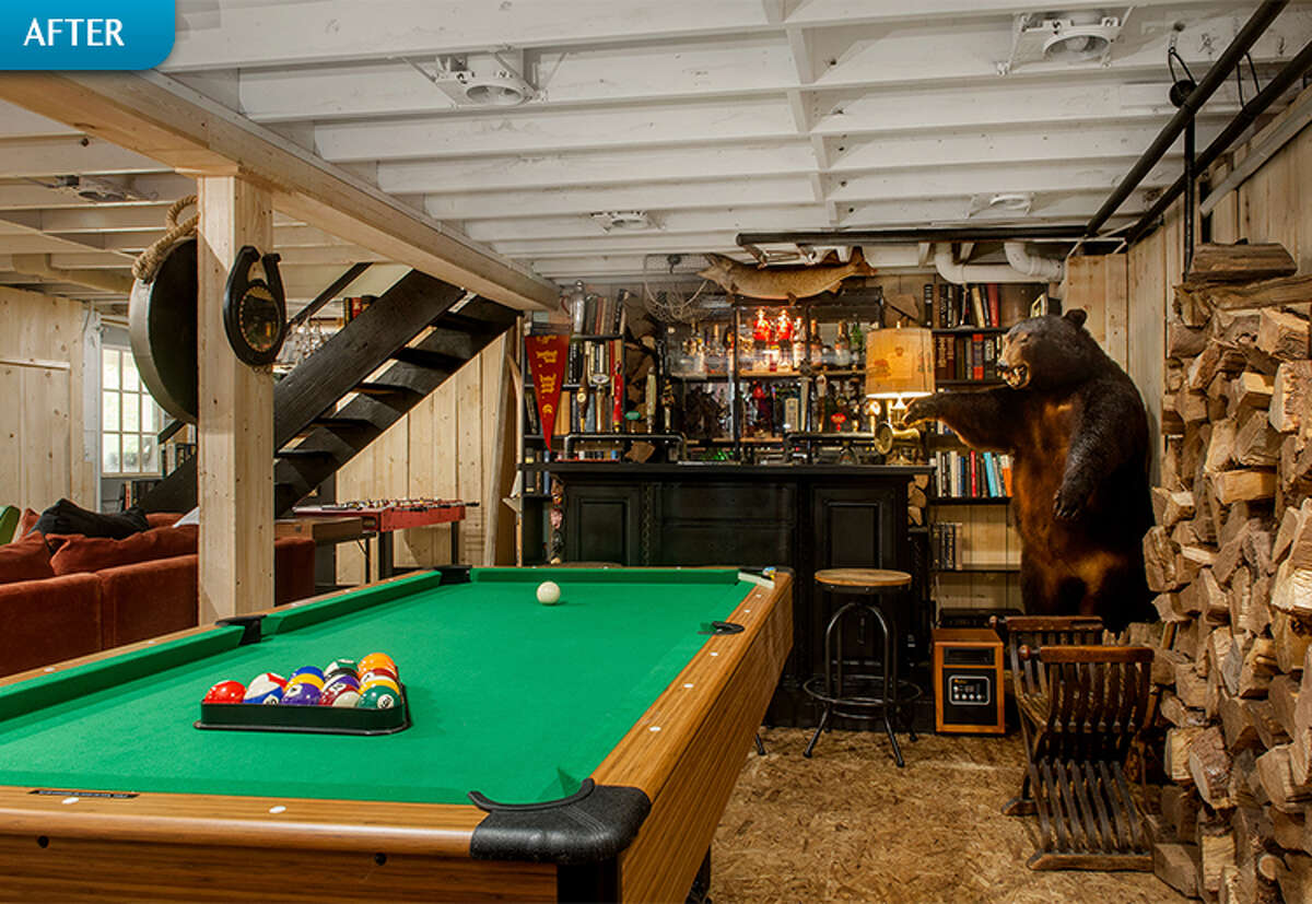 """AFTER: Says Fuller of the renovated space: """"The basement is mostly used by friends who stop by and enjoy reading, watching old movies, playing a game of pool, or just hanging out at the bar."""""""