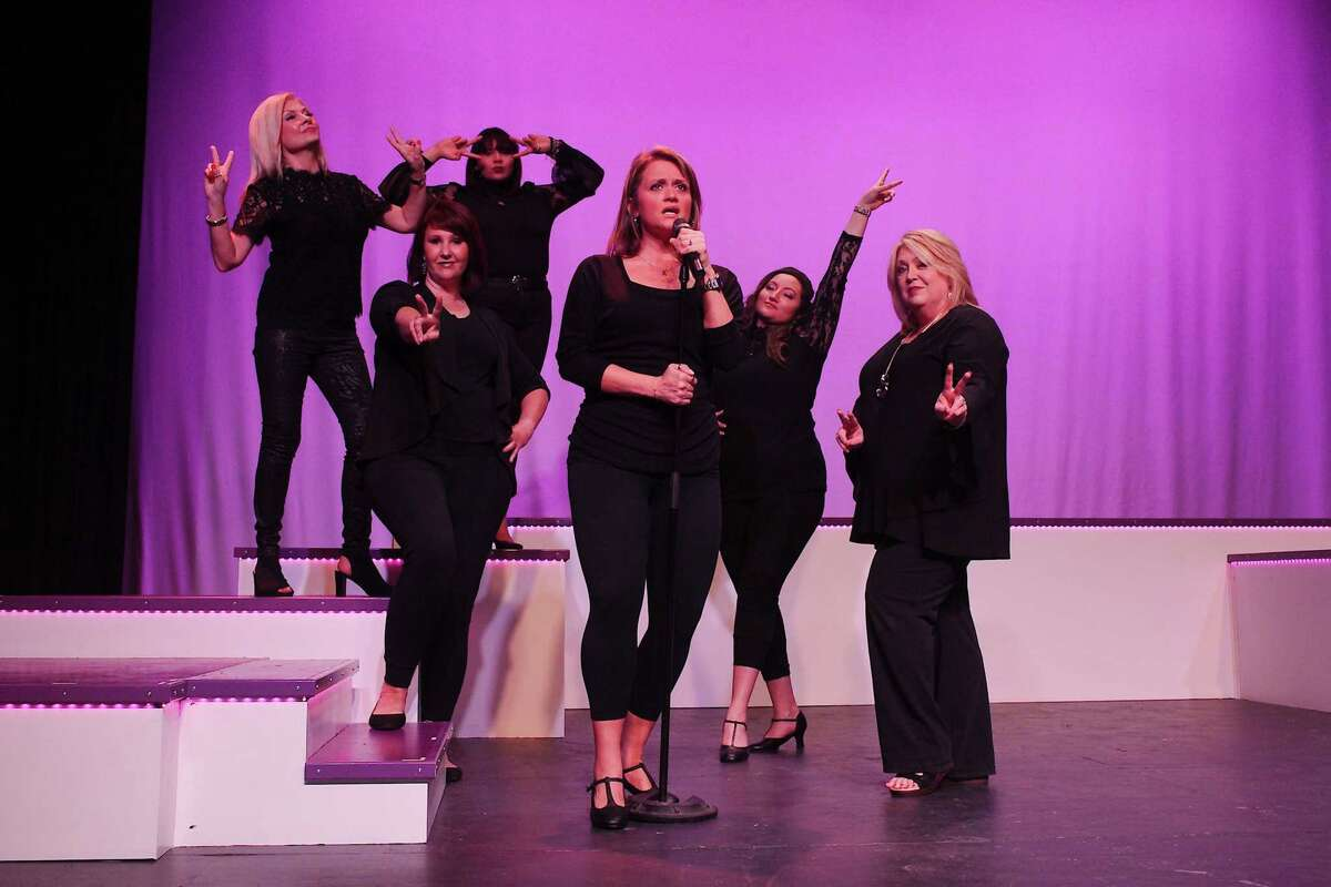 Margo Staley, center, takes the lead for a '60s song in