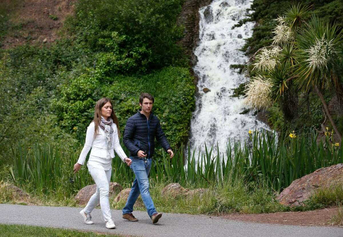 Maria Pastor and Javier Echavarria, both visiting from Spain, stroll past Rainbow Falls on JFK Drive at Golden Gate Park in San Francisco, Calif. on Wednesday, May 10, 2017. A biennial survey of San Francisco residents conducted by the city gives recreation and parks an overall B grade.