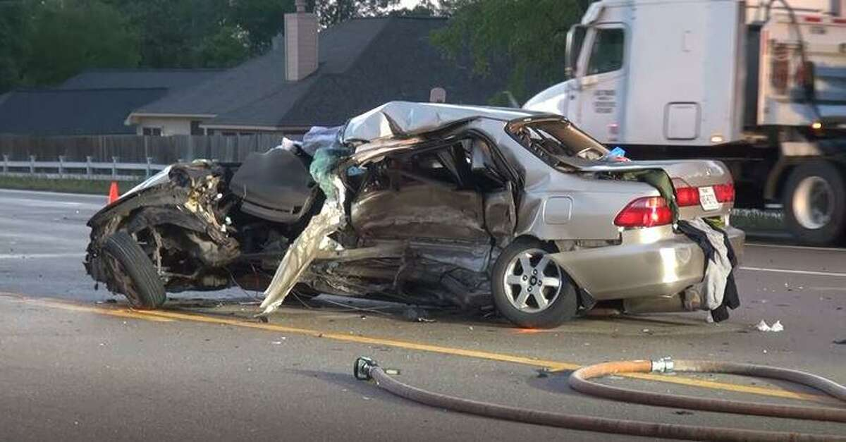 A 2000 Honda Accord is seen Thursday evening on Texas 105 West in Conroe after being struck by two vehicles. The Accord's driver died as a result.