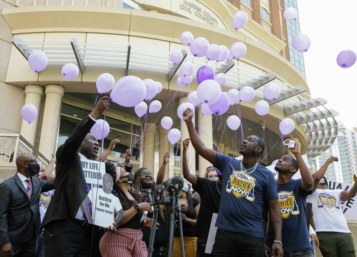 Pamela Turner's family and activists release balloons to commemorate her 46th birthday, after a press conference in which attorney Benjamin Crump announced the filing of a federal lawsuit against Baytown Police officer Juan Delacruz in Turner's death outside the Harris County Civil Courthouse on Thursday, April 8, 2021, in Houston. Turner, who would have turned 46 years old today, was shot and killed on May 13, 2019.