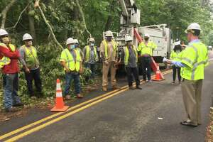 James Judge, right, visited a group of line workers during the post-Isaias storm recovery in Connecticut.