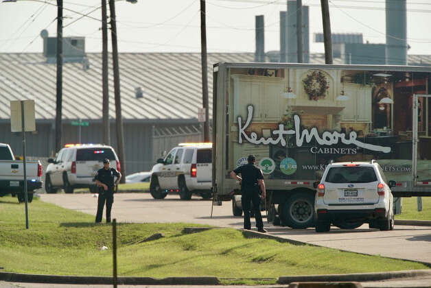 Police block off a road leading to the scene of a shooting at Kent Moore Cabinets on Thursday, April 8, 2021, in Bryan. At least one person is reported dead, and six people were hospitalized. Photo: Mark Mulligan, Staff Photographer / 2021