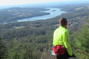 The Tomhannock Reservoir dominates the view from a lookout on the Vultures View Trail in Grafton Forest.
