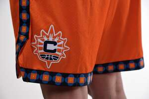 "This photo provided by Connecticut Sun on Thursday, April 8, 2021, shows the new Nike ""Explorer"" edition uniform for the Connecticut Sun WNBA team. As numerous sports teams continue to come under fire for using Native American names and symbols, The Connecticut Sun is putting them on their new jerseys with the input of the team's owners—the Mohegan Indian tribe. (Connecticut Sun/Khoi Ton via AP)"