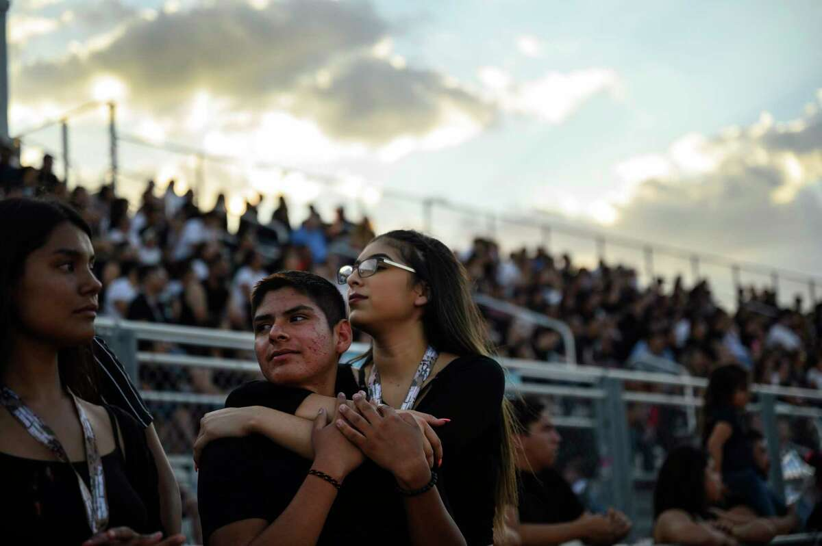 Horizon High School students comfort one another during an Aug. 5, 2019, memorial service for Javier Amir Rodriguez. The 15-year-old was one of the victims of a gunman on Aug. 3 at a Walmart in the Texas border city.
