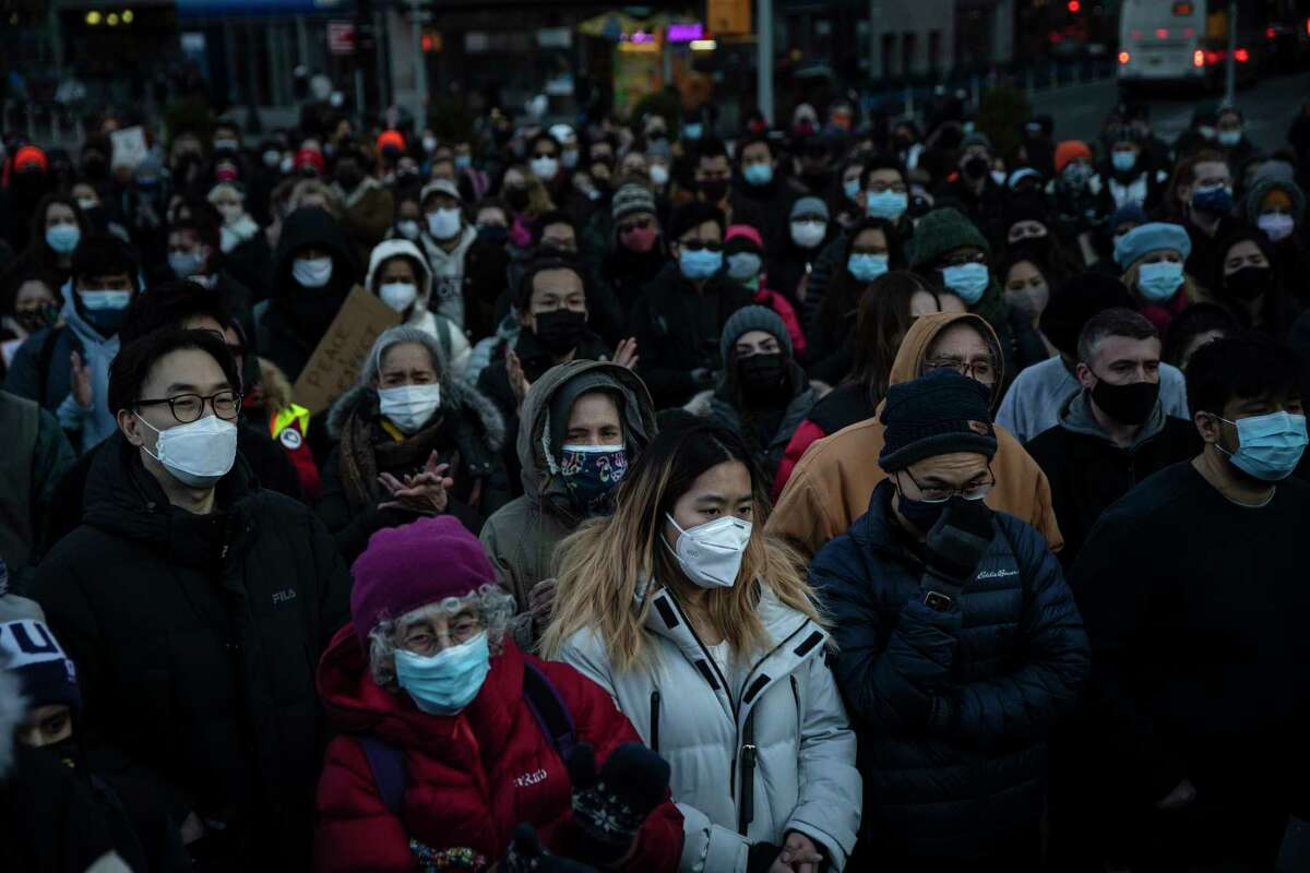 New Yorkers gather in Union Square, N.Y., on March 19, 2021, for a vigil mourning lives lost earlier in the week when a gunman in targeted three Asian-owned businesses in the Atlanta area.