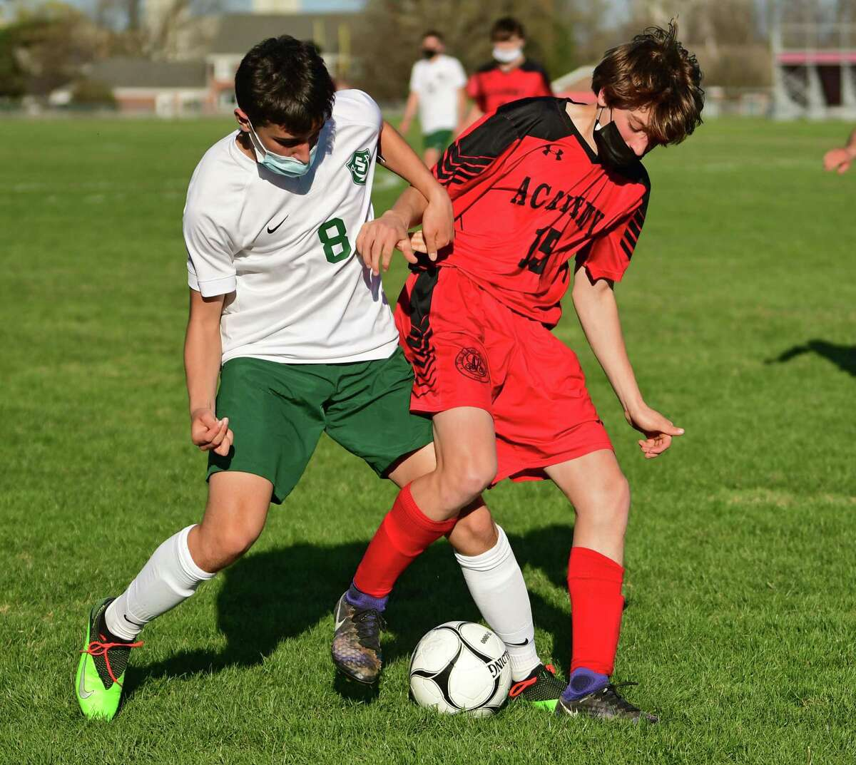 Schalmont's Andrew Kusek, left, and Albany Academy's Tommy McGuire battle for the ball in a game last season. Kusek scored nine goals in two games in the week running from Sept. 6-12 to earn Athlete of the Week honors.