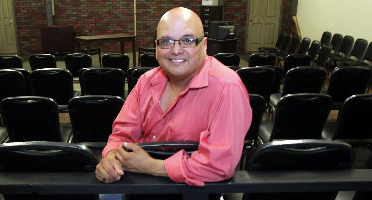 Actor and director Greg Hinojosa sits in the black box theater at the Woodlawn Theater, which he ran for a couple of years. Hinojosa died on Thursday.
