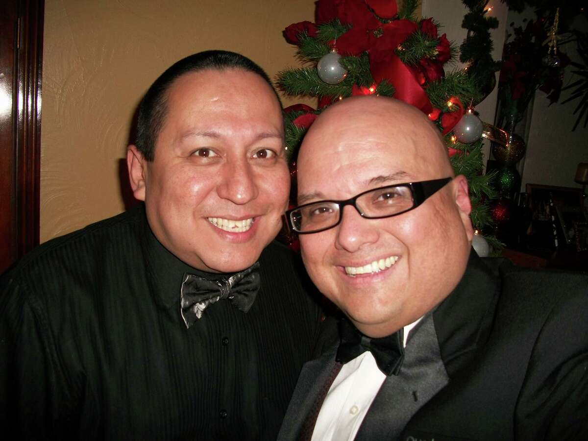 Greg Hinojosa (right) produced the Fiesta Frenzy fundraiser with his husband Daniel Acosta.