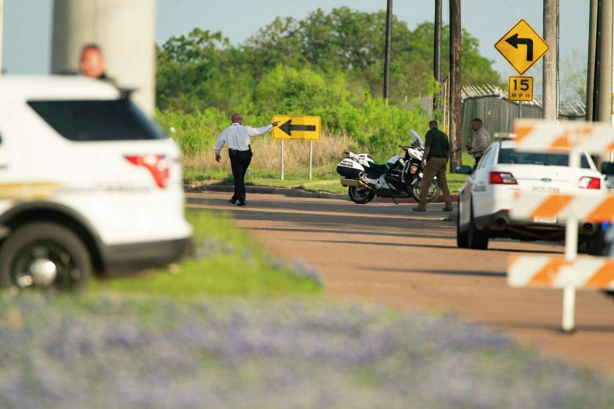 Police block off a road leading to the scene of a shooting at Kent Moore Cabinets on Thursday, April 8, 2021, in Bryan. At least one person is reported dead, and six people were hospitalized.