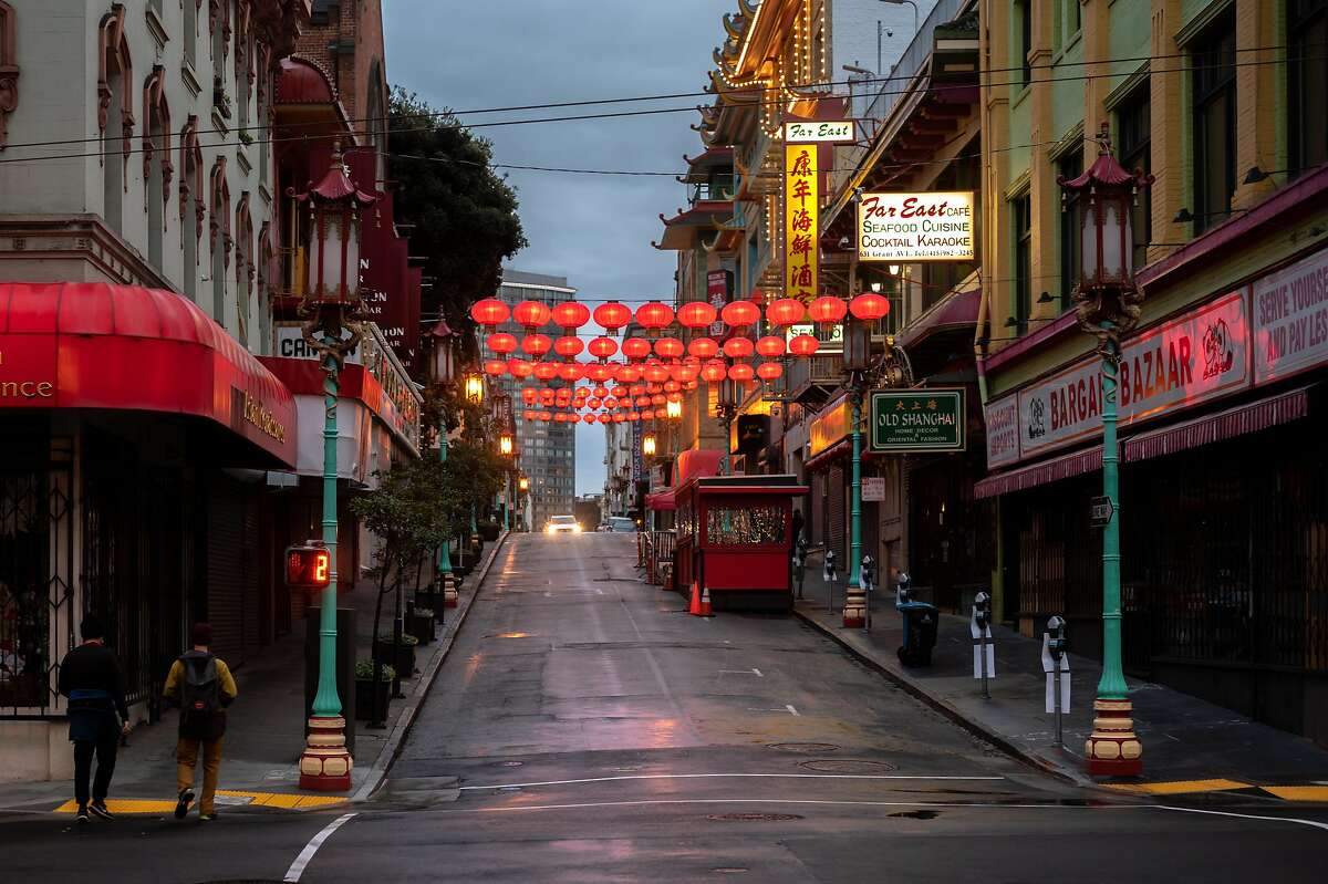 Chinatown Saftey Patrol volunteers patrol the empty streets of San Francisco Chinatown on March 18, 2021. With the recent increase of hate crimes against Asian Americans and killing of 8 in Atlanta, a drastic increase of volunteers have showed up every night to help residents feel safe by patroling Asian American neighborhoods.