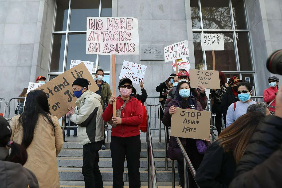 Demonstrators rally in front of the Hall of Justice as they demand justice for Vicha Ratanapakdee on Monday, March 22, 2021 in San Francisco, Calif. Vicha Ratanapakdee died after being pushed to the pavement as he walked through the city's Anza Vista neighborhood.