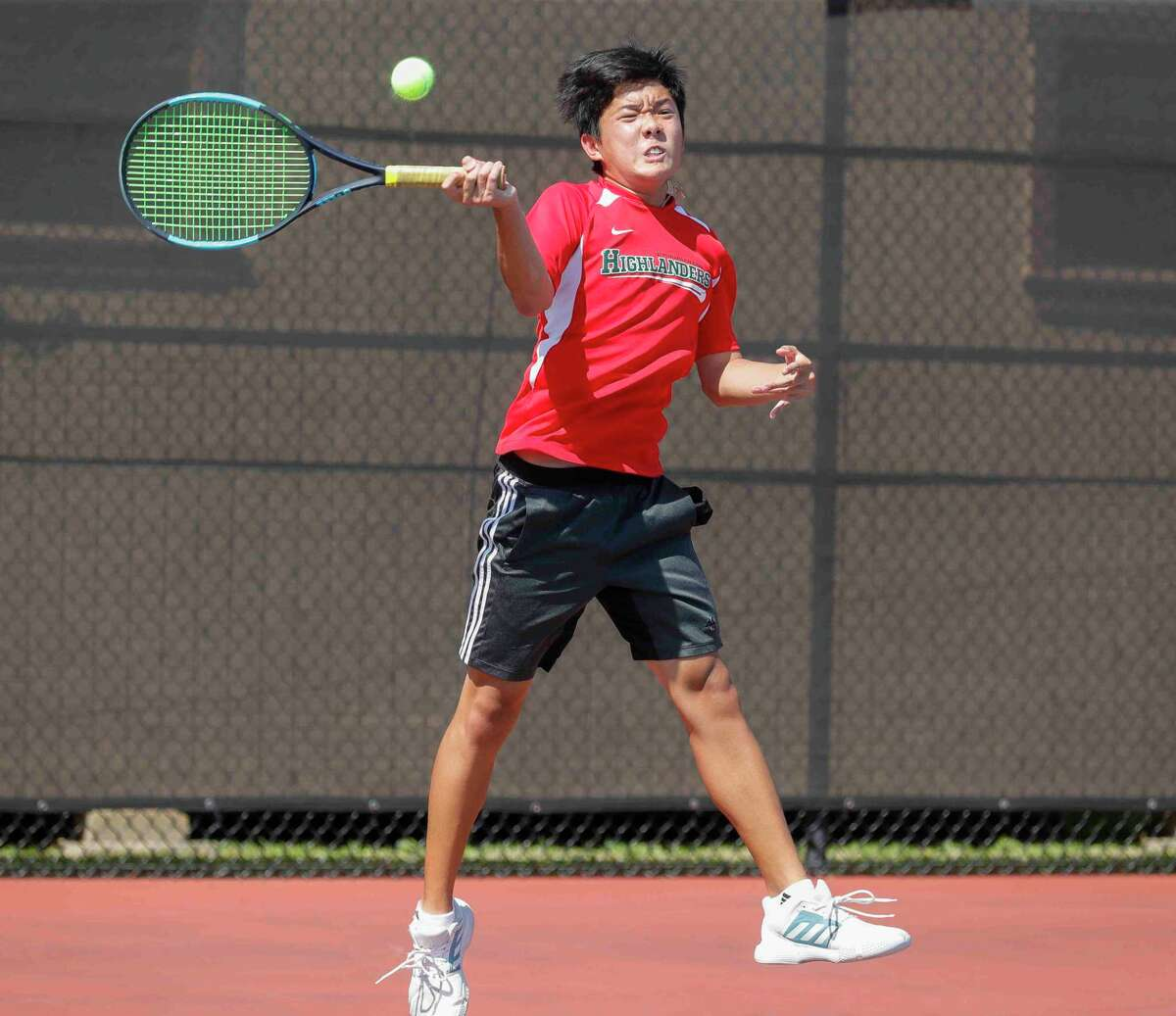 Eli Sam of The Woodlands returns a serve in a boys doubles championship match during the District 13-6A high school tennis tournament at The Woodlands High School, Thursday, April 8, 2021, in The Woodlands.