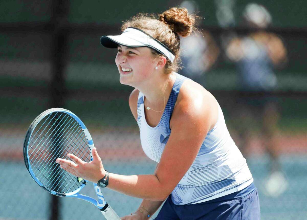 Caitlin Behne of College Park reacts after a shot during a mix doubles championship match during the District 13-6A high school tennis tournament at The Woodlands High School, Thursday, April 8, 2021, in The Woodlands.