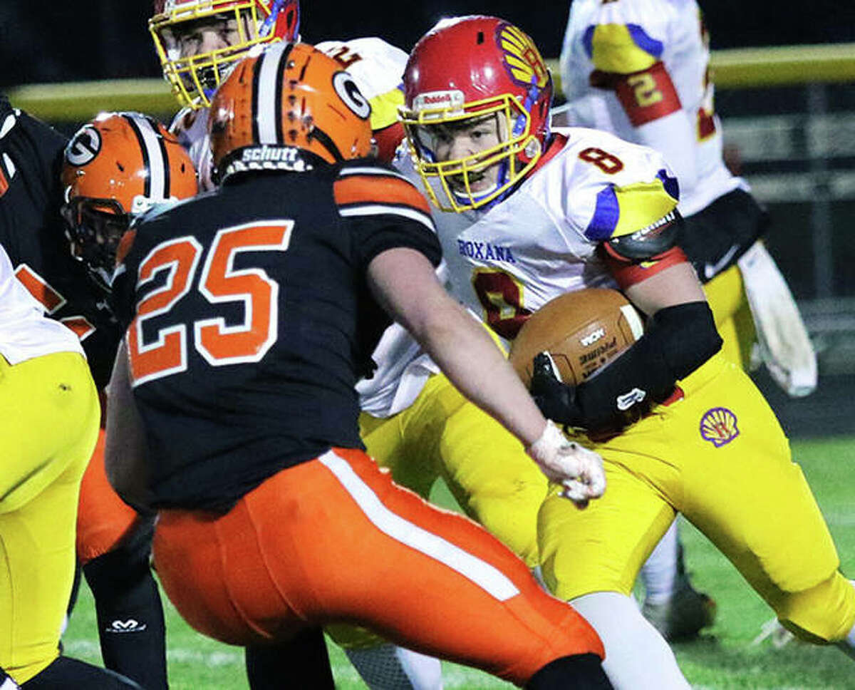 Roxana RB Nik Ward eyes contact with Gillespie's Dillon Lewis (25) in Friday night's SCC football game at Gillespie.