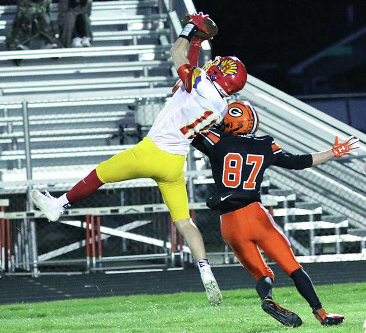 Roxana's Braeden Wells goes up high for an interception of a pass intended for Gillespie's Tanner Whitfield (87) on Friday night at Don Dobrino Field in Gillespie.