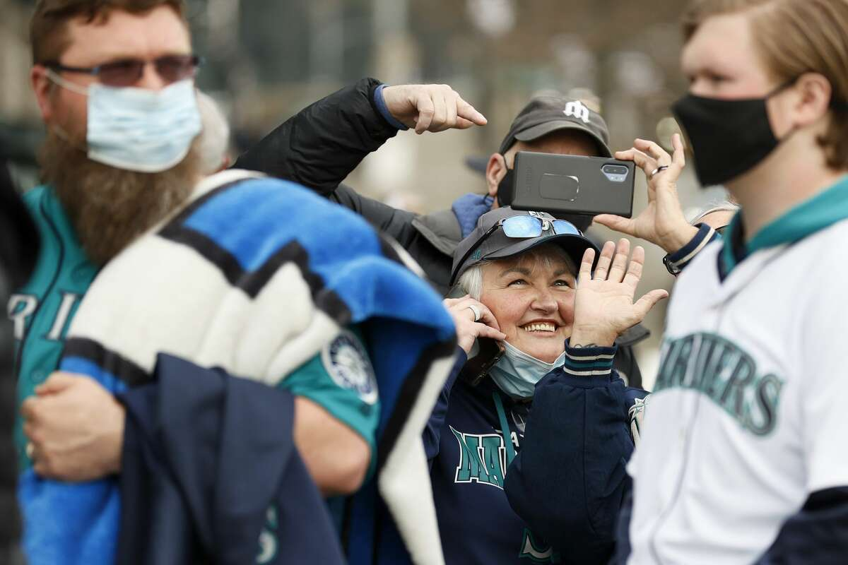 SEATTLE, WASHINGTON - APRIL 01: Fans wait outside before Opening Day between the Seattle Mariners and the San Francisco Giants at T-Mobile Park on April 01, 2021 in Seattle, Washington. (Photo by Steph Chambers/Getty Images)