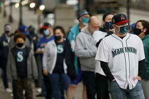 SEATTLE, WASHINGTON - APRIL 01: Fans wait in line before the game between the Seattle Mariners and the San Francisco Giants on Opening Day at T-Mobile Park on April 01, 2021 in Seattle, Washington. (Photo by Steph Chambers/Getty Images)