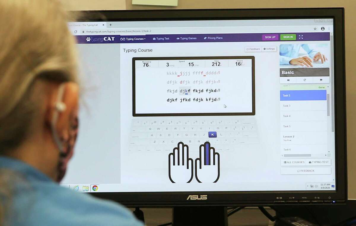 A client uses a typing program at a computer station at Workforce Solutions Alamo. The organization and CEO Adrian Lopez act as the lead for intake and as a clearinghouse for job applicants. Lopez was at the organization's newest center where, due to the pandemic and safety protocols, are accepting appointments only for job applicants to search for potential work in the area.