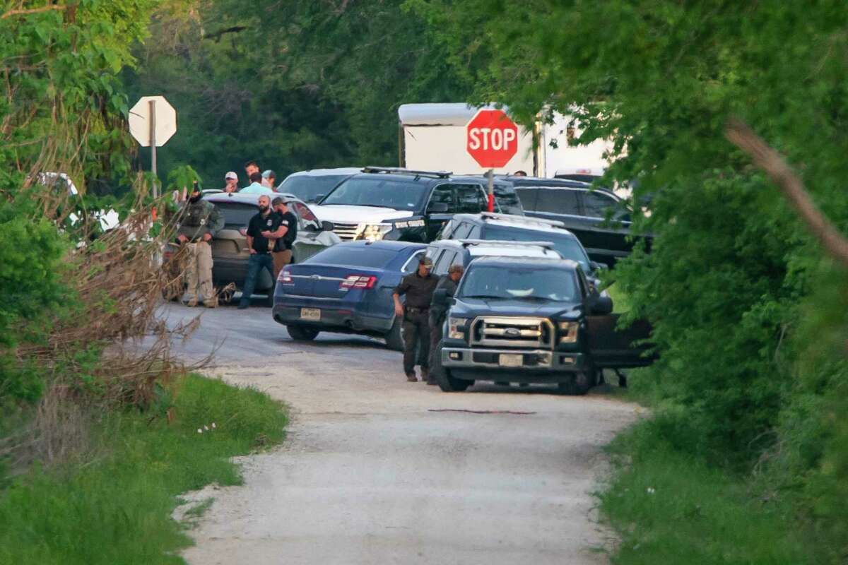 State and local police use use a speaker to talk to the possible occupants of a house near Iola near where a State Trooper was shot earlier in the day after an earlier shooting at Kent Moore Cabinets in Bryan on Thursday, April 8, 2021. At least one person is reported dead, and six people were hospitalized.