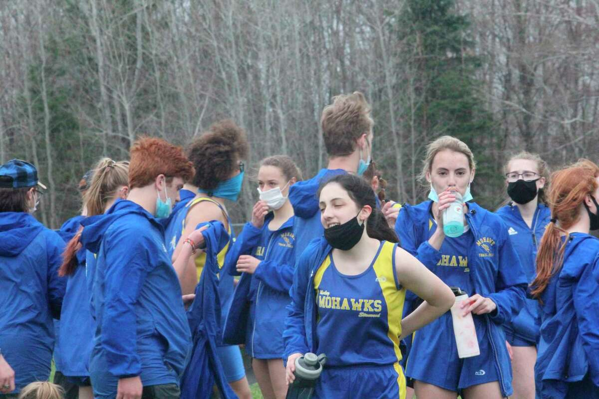 Morley Stanwood girls and boys track and field athletes celebrate their win over Montabella on Thursday. (Pioneer photo/John Raffel)