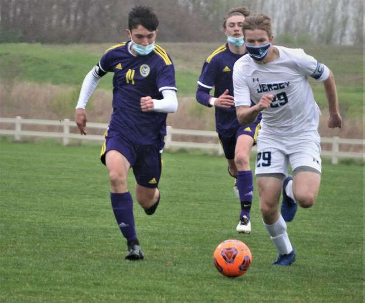 Civic Memorial's Brayden Zyung (14) and Adam Kribs of Jersey chase the ball in first-half action Thursday at the Bethalto Sports complex.
