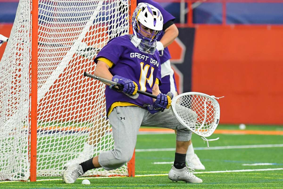 UAlbany goalie Liam Donnelly makes a save against Syracuse during the first half at the Carrier Dome on Thursday, April 8, 2021.