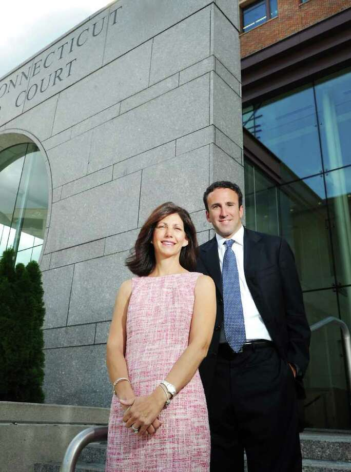 Karen Kaiser stands with her attorney Mark Sherman in front of state  Superior Court in Stamford, Conn. on Friday September 10, 2010.  Kaiser's divorce lawsuit helped bring down Pequot Capital Management, the Wilton company that managed billions of dollars and was once among the world's biggest hedge funds. Photo: Kathleen O'Rourke / Stamford Advocate