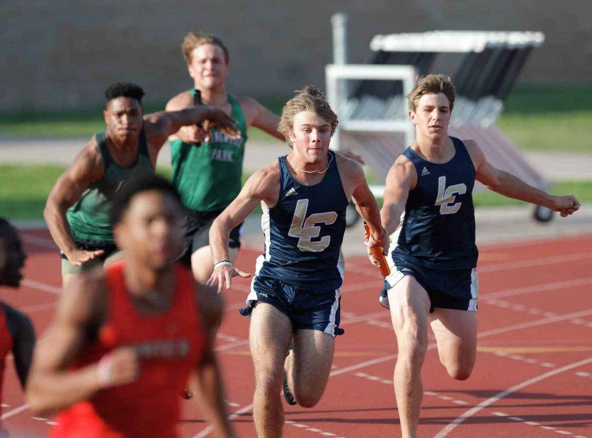 Lake Creek competes in the boys 4x100 meter relay during the District 20-5A track and field championships at Turner Stadium, Thursday, April 8, 2021, in Humble.