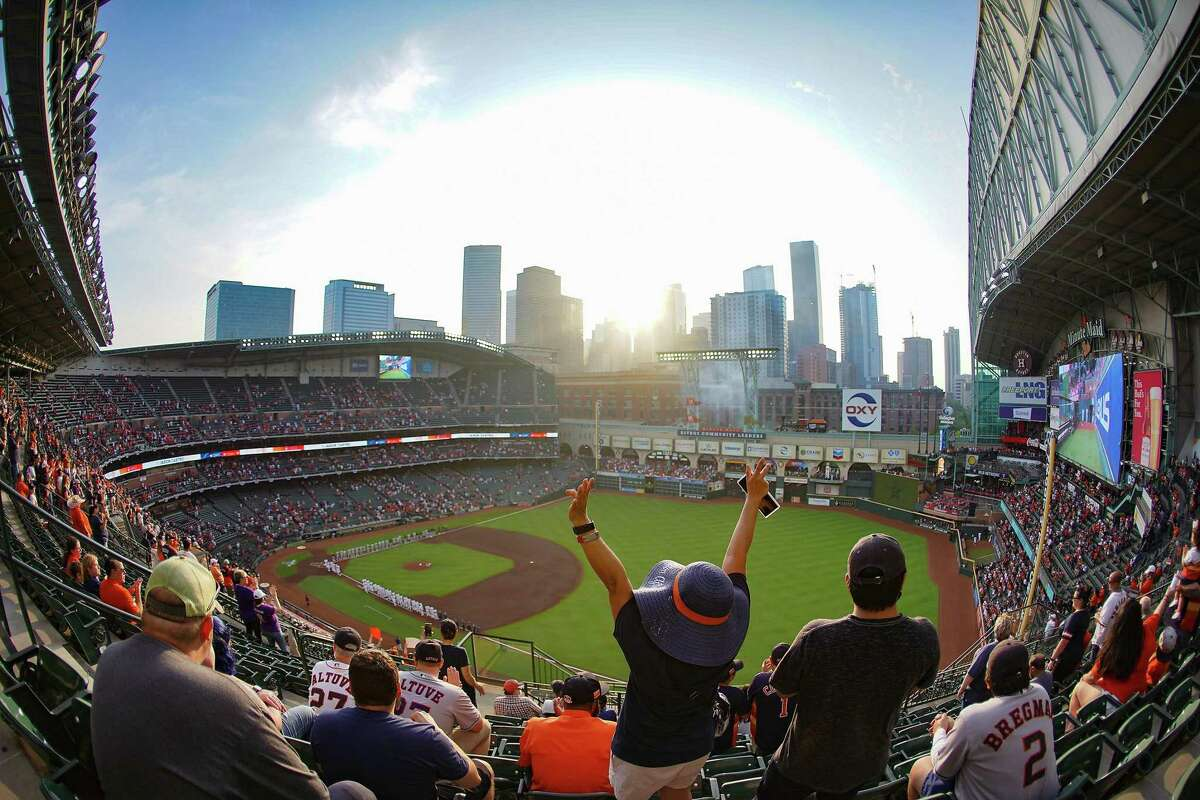 Astro fans react to the opening ceremonies of the Houston Astros home opener against the Oakland A's at Minute Maid Park in Houston on Thursday, April 8, 2021.