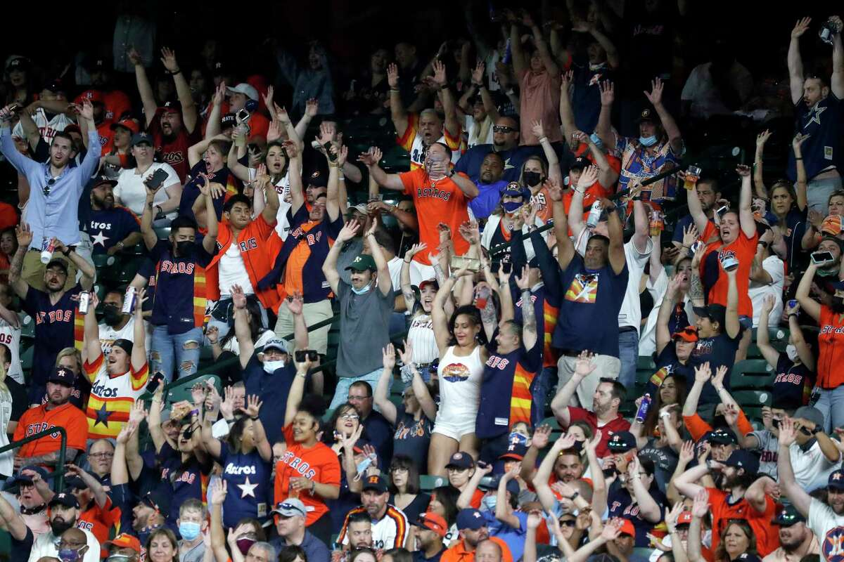 Fans do the wave during the seventh inning of the Astros' home opener at Minute Maid Park on Thursday night.