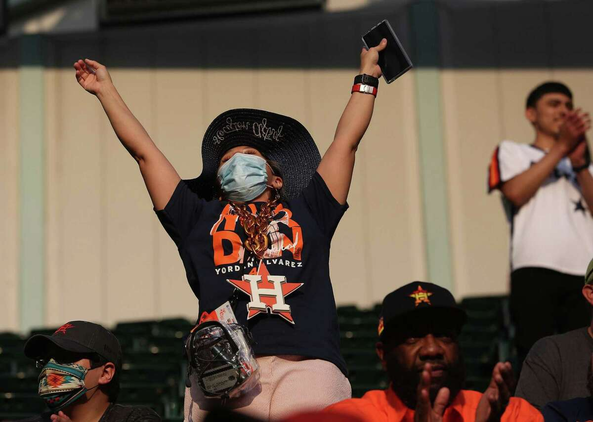 A Houston Astros fan reacts during the opening ceremonies of the team's home opener against Oakland A's at Minute Maid Park in Houston on Thursday, April 8, 2021.