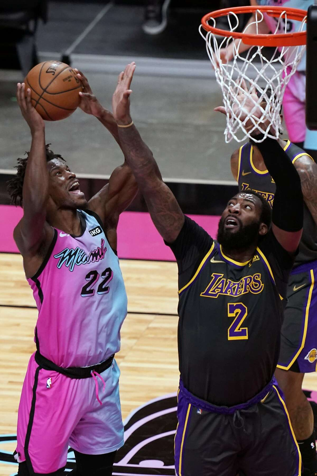 Miami's Jimmy Butler shoots over the Lakers' Andre Drummond, who returned after missing four games.