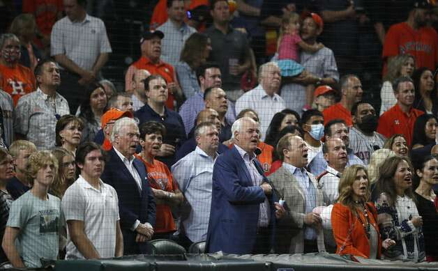 Fans sing God Bless America during the Seventh Inning stretch of the Astros home opener MLB baseball game at Minute Maid Park, in Houston, Thursday, April 8, 2021. Photo: Karen Warren/Staff Photographer / @2021 Houston Chronicle
