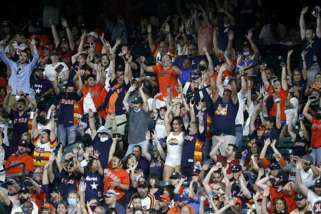 Fans do the wave during the seventh inning of the Astros home opener MLB baseball game at Minute Maid Park, in Houston, Thursday, April 8, 2021. Photo: Karen Warren/Staff Photographer / @2021 Houston Chronicle