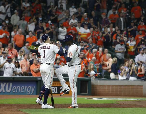 Houston Astros Yordan Alvarez (44) reacts with Carlos Correa (1) after his home run during the sixth inning of the Astros home opener MLB baseball game at Minute Maid Park, in Houston, Thursday, April 8, 2021. Photo: Karen Warren/Staff Photographer / @2021 Houston Chronicle