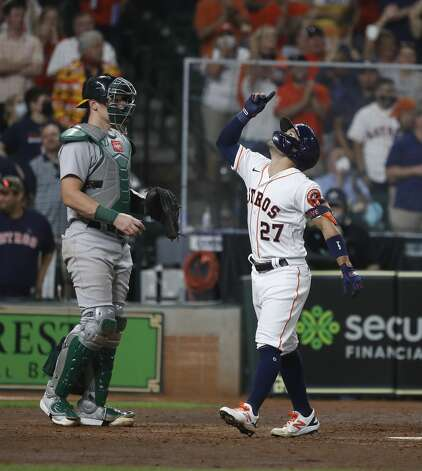 Houston Astros Jose Altuve (27) celebrates after hitting a home run during the seventh inning of the Astros home opener MLB baseball game at Minute Maid Park, in Houston, Thursday, April 8, 2021. Photo: Karen Warren/Staff Photographer / @2021 Houston Chronicle