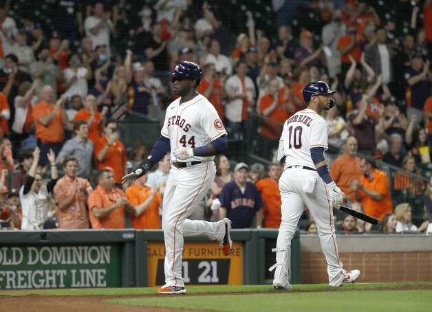 Houston Astros Yordan Alvarez (44) scores a run on Carlos Correa's RBI double during the fourth inning of the Astros home opener MLB baseball game at Minute Maid Park, in Houston, Thursday, April 8, 2021. Photo: Karen Warren/Staff Photographer / @2021 Houston Chronicle